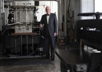 Andrew Hoyem in front of a printing press.