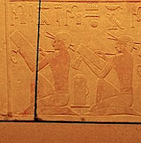 Detail from wall of tomb of Prince Kaninisut showing scribes in seated position. Please click on image to view larger image.