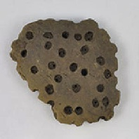 <p>Fragment of clay sieve from central Europe.&nbsp; Credit: M&eacute;lanie Salque.</p>
