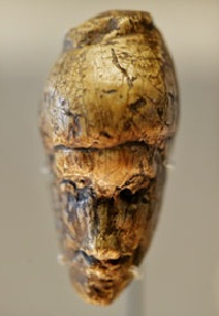 The oldest known portrait of a woman, sculpted from mammoth ivory during the last ice age around 26,000 years ago.  Photograph: Graeme Robertson for The Guardian. (Click on image to view larger.)
